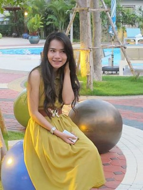 a Thai girl in yellow dress